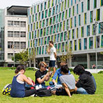Students on Alumni Green in front of the new science building
